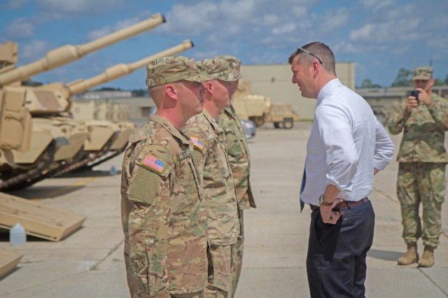 The Under Secretary of the Army, Patrick J. Murphy, visits Soldiers at the 2nd Bn, 7th Inf. Regt, 1ABCT, 3rd ID motor pool, Aug. 10. The Cottonbaler Soldiers briefed their unit's mission and showed off their tank's capabilities.