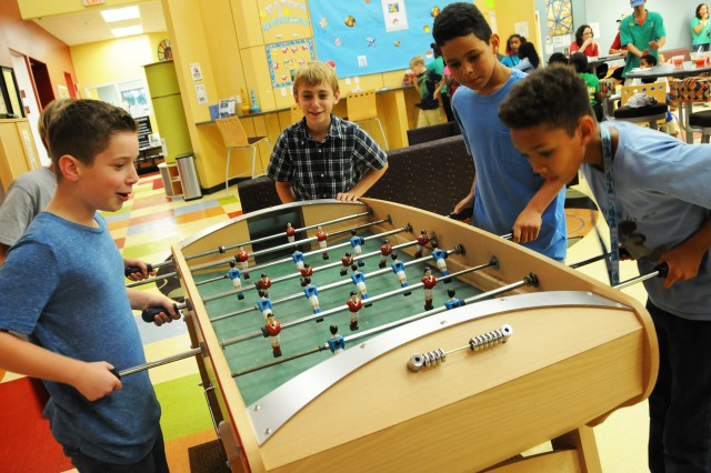 Children play foosball during the youth center Ice Block Party Aug. 12.