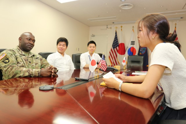 Yurie Horiuchi, PAO intern, interviews Lt. Col. Johnny King, director of health promotion and wellness for PHC-P, and other interns (U.S. Army photo by Kyoka Fujiwara).