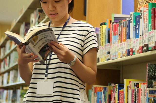 Kanade Ueno, library intern, researches about travel in Japan at the Camp Zama Library (U.S. Army photo by Yurie Horiuchi).