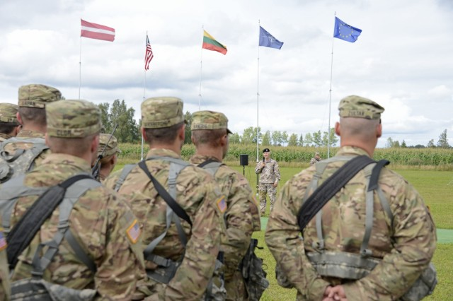 Soldiers of the 210th Military Police Battalion, 177th Military Police Brigade, Michigan National Guard, listen to 1st Region Zemessardze Commander, Col. Gailis, during the closing ceremony of ‪‎Strong Guard‬ 2016 (‪‎Zobens‬ 2016) near Tukums, Latvia, Aug. 14, 2016.  Strong Guard demonstrated the continued U.S. commitment to the security of the NATO Allies in the light of the increased tension in Eastern Europe.