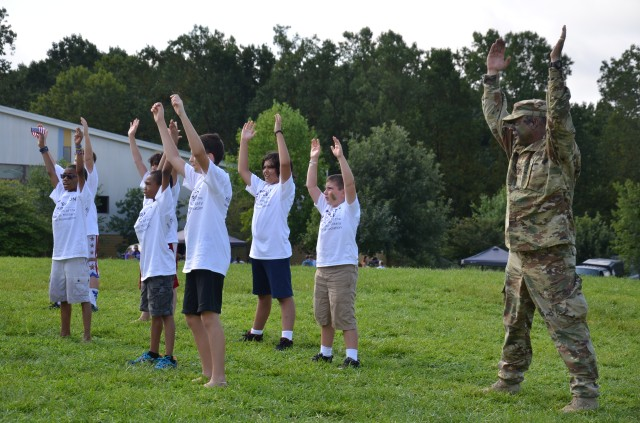 Soldiers, Army civilians break battle rhythm to support camp for military kids