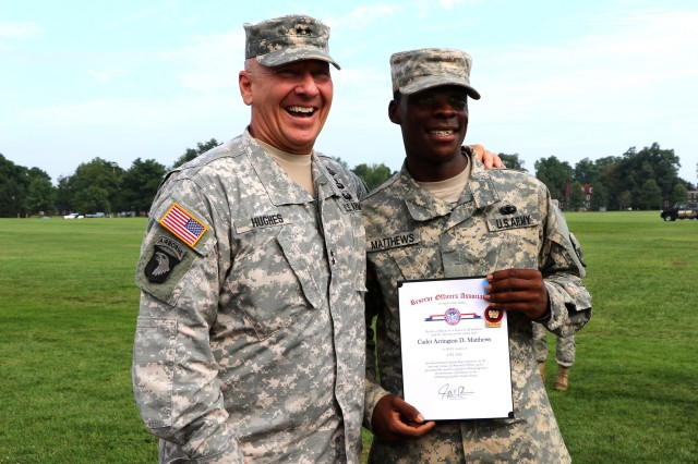 Maj. Gen. Christopher P. Hughes, Commander U.S. Army Cadet Command and Fort Knox, takes a photo with 6th Regiment Advanced Camp (CLC) Cadet Arrington D. Matthews, Bowie State University, Reserve Officer Association Award recipient, after his graduation on Brooks Field at Fort Knox, Ky. July 27.