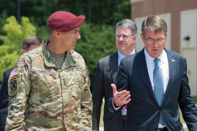 Defense Secretary Ash Carter speaks with Army Lt. Gen. Stephen J. Townsend