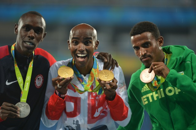 Silver medalist Spc. Paul Chelimo (left) of the U.S. Army World Class Athlete Program poses with gold medalist Mo Farah (center) of Great Britain and bronze medalist Hagos Gebrhiwet (right) of Ethiopia on Aug. 20 at Olympic Stadium in Rio de Janeiro, Brazil.