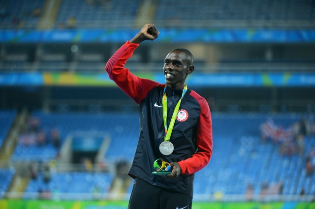 Spc. Paul Chelimo of the U.S. Army World Class Athlete Program finishes runner-up to Mo Farah of Great Britain to claim the silver medal in the men's 5,000-meter run with a personal-best time of 13 minutes, 3.90 seconds Aug. 20, 2016 at the 2016 Olympic Games in Rio de Janeiro, Brazil. Farah won the gold in 13:03.30 and Hagos Gebrhiwet of Ethiopia took the bronze in 13:04.35. Chelimo was disqualified from the race but later reinstated and collected his silver medal at the awards ceremony, which was delayed to sort it out.