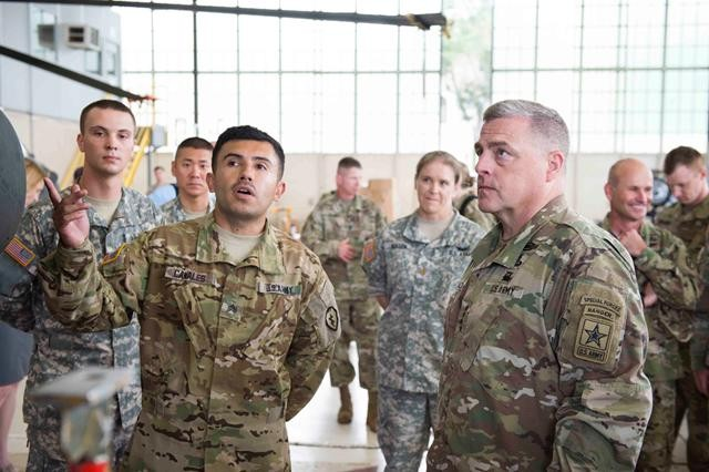 A 25th Combat Aviation Brigade Soldier explains AH-64 Apache helicopter maintenance to Gen. Mark A. Milley during the Chief of Staff's visit to Wheeler Army Airfield Aug. 23.