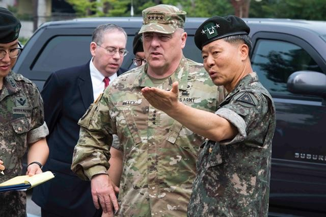 Gen. Jang Jun-Kyu, Chief of Staff of the Republic of Korea Army, shows Gen. Mark A. Milley, Chief of Staff of the U.S. Army, his headquarters before a meeting in Seoul Aug. 19.