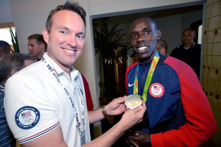 Secretary of the Army Eric Fanning holds the silver medal won by Spc. Paul Chelimo of the U.S. Army World Class Athlete Program, Aug. 21, 2016, at the USA House in Rio de Janerio.