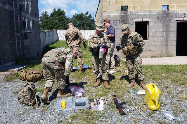 Human Intelligence (HUMINT) Collectors from the Military Intelligence Company, 54th BEB, 173rd Airborne Brigade triage captured enemy materials after conducting sensitive site exploitation utilizing the Rapid Site Exploitation kits.