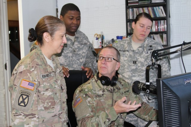 Indiana National Guard Master Sgt. Bradley Staggs (sitting), of the 38th Infantry Division, shows U.S. Army Reserve Soldiers with the 206th Broadcast Operations Detachment and 205th Press Camp Headquarters how to run radio broadcast equipment during Exercise News Day at MUTC on Aug. 23, 2016.