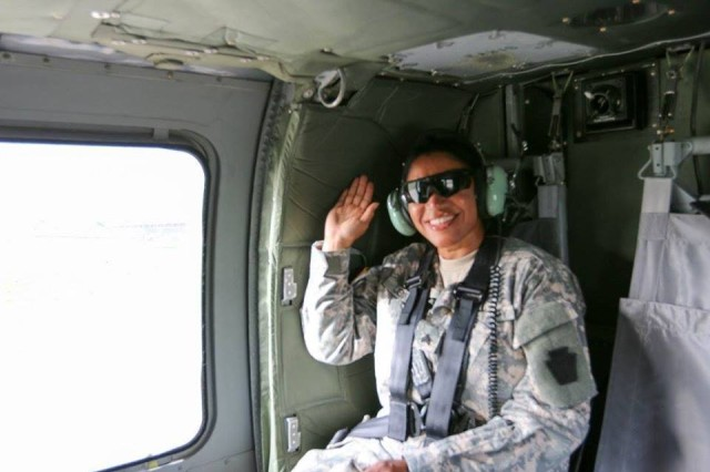 Sgt. Nilda Jenkins, mortuary affairs noncommissioned officer assigned to the Pennsylvania National Guard's 28th Infantry Division, rides in a UH-60 Black Hawk on the way to her reenlistment ceremony at Camp Film City, Kosovo, April 18, 2016.