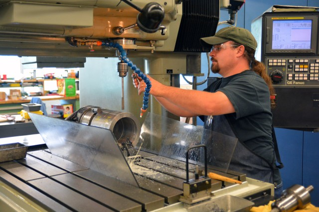 Toolmaker Michael Pantuosco machining in the tool room during the annual shutdown.