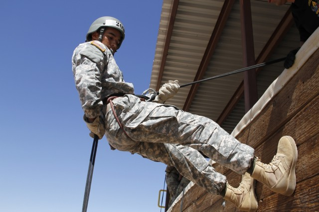 Army Spc. Johnathon Chon, assigned to 11th Air Defense Artillery Brigade, rappels down a tower at the Air Assault School at Fort Bliss, Texas, Aug. 19, 2016. The most recent air assault class graduated Aug. 24, 2016.