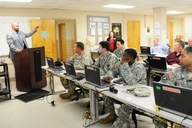 Miguel Boschulte, VA benefit adviser, talks to Soldiers about the different programs that can assist them during a class at the education center earlier this year.