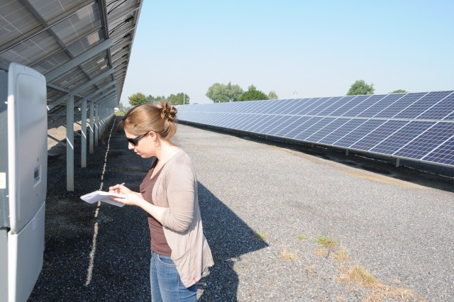 Mélanie Chaballe, energy manager, checks the solar panel inverters on Chièvres Air Base.