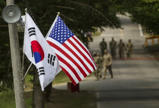 American and South Korean flags at Yongin