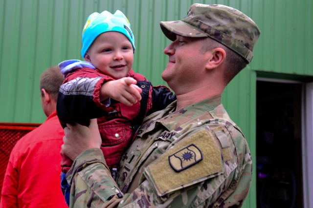 U.S. Army 1st Lt. John Sorich, assigned to Alpha Company, 457th Civil Affairs Battalion, 361st Civil Affairs Brigade, 7th Mission Support Command, holds a child from Kudikiu Namai during a Humanitarian Civil Assistance (HCA) project in Sauliai, Lithuania, Aug. 18, 2016. As part of the European Command's (EUCOM) Humanitarian and Civic Assistance Program, the 375th Engineer Company, 457th Civil Affairs Battalion and the Lithuanian military collaborate to renovate the fence at Kudikiu Namai, an orphanage for Lithuanian children up to the age of 6, in Sauliai, Lithuania, August 8-26, 2016. The Humanitarian and Civic Assistance Program is a series of medical and engineering engagements in several European countries in support of strategic, theater, operational and tactical objectives. (U.S. Army photo by Pfc. Emily Houdershieldt)