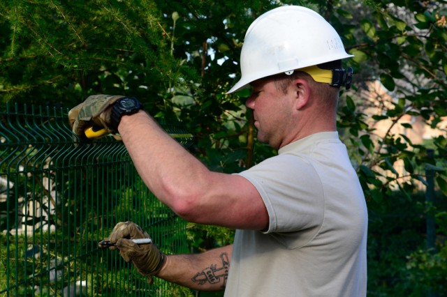 U.S. Army Spc. Jimmy Martin, assigned to the 375th Engineer Company, 467th Engineer Battalion, 926th Engineer Brigade, 412th Theater Engineer Command, assists with constructing a fence during a Humanitarian Civil Assistance (HCA) project in Sauliai, Lithuania, Aug. 19, 2016. As part of the European Command's (EUCOM) Humanitarian and Civic Assistance Program, the 375th Engineer Company, 457th Civil Affairs Battalion and the Lithuanian military collaborate to renovate the fence at Kudikiu Namai, an orphanage for Lithuanian children up to the age of 6, in Sauliai, Lithuania, August 8-26, 2016. The Humanitarian and Civic Assistance Program is a series of medical and engineering engagements in several European countries in support of strategic, theater, operational and tactical objectives. (U.S. Army photo by Pfc. Emily Houdershieldt)