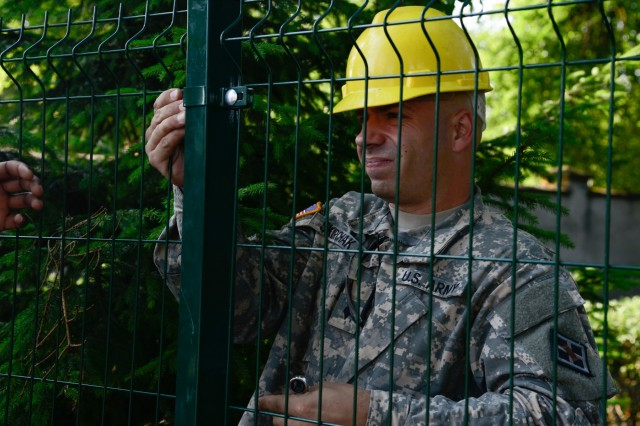 U.S. Army Spc. Nick Shirchak, assigned to the 375th Engineer Company, 467th Engineer Battalion, 926th Engineer Brigade, 412th Theater Engineer Command, assists with constructing a fence during a Humanitarian Civil Assistance (HCA) project in Sauliai, Lithuania, Aug. 19, 2016. As part of the European Command's (EUCOM) Humanitarian and Civic Assistance Program, the 375th Engineer Company, 457th Civil Affairs Battalion and the Lithuanian military collaborate to renovate the fence at Kudikiu Namai, an orphanage for Lithuanian children up to the age of 6, in Sauliai, Lithuania, August 8-26, 2016. The Humanitarian and Civic Assistance Program is a series of medical and engineering engagements in several European countries in support of strategic, theater, operational and tactical objectives. (U.S. Army photo by Pfc. Emily Houdershieldt)