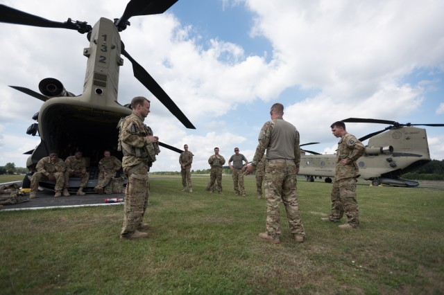 "Soldiers from Hotel Company, 1st Battalion, 214th Aviation Regiment, 12th CAB ""Big Windy,"" receive their air crew brief in preparation for crew chief door gunner qualifications at Grafenwoehr training area, Germany, Aug. 13, 2016.  Aviation gunnery trains individuals, crews, and companies on weapons proficiency and validates the operational readiness of the unit. (U.S. Army photo by Spc. Antonio Ramirez, 12th CAB)"