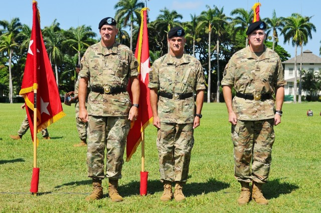 """U.S. Army Pacific commanding general Gen. Robert B Brown (left); Maj. Gen. Charles A. Flynn (center), former commander of the 25th Infantry Division, Schofield Barracks, and incoming Deputy Commanding General, South, USARPAC; and Brig. Gen. Brian E. Alvin, outgoing Deputy Commanding General, Reserves, USARPAC; stand ready for a Flying """"V"""" ceremony held at historic Palm Circle, Fort Shafter, Hawaii, August 25. The ceremony was held to honor Alvin for his distinguished service as he prepares to depart USARPAC, and to welcome Flynn, as he assumes the responsibilities of Deputy Commanding General, South.  The """"V"""" refers to the way the colors are posted during the ceremony, which is V-shaped. (U.S. Army photo by Staff Sgt. Chris McCullough, U.S. Army Pacific Public Affairs)"""