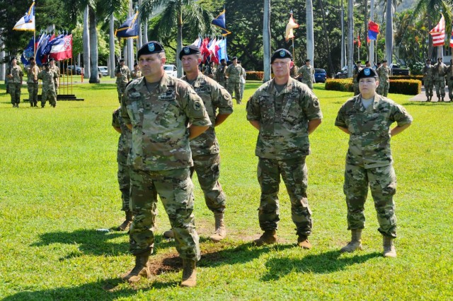 """Col. Olin K. Strader, Commander of Troops, presents the U.S. Army Pacific Color Guard during U.S. Army Pacific's Flying """"V"""" ceremony at historic Palm Circle, Fort Shafter, Hawaii, August 25. The Flying """"V"""" ceremony was held to honor Brig. Gen. Brian E. Alvin (not pictured), outgoing Deputy Commanding General, Reserves, USARPAC, for his distinguished service as he prepares to depart USARPAC, and to welcome Maj. Gen. Charles A. Flynn (not pictured), former commander of the 25th Infantry Division, Schofield Barracks, as he assumes the responsibilities of Deputy Commanding General, South. The """"V"""" refers to the way the colors are posted during the ceremony, which is V-shaped. (U.S. Army photo by Staff Sgt. Chris McCullough, U.S. Army Pacific Public Affairs)"""