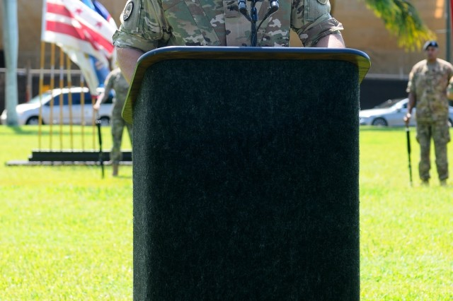 """Brig. Gen. Brian E. Alvin, outgoing Deputy Commanding General, Reserves, U.S. Army Pacific, addresses the audience during USARPAC's Flying """"V"""" ceremony at historic Palm Circle, Fort Shafter, Hawaii, August 25. The Flying """"V"""" ceremony was held to honor Maj. Gen. Charles A. Flynn (not pictured), former commander of the 25th Infantry Division, Schofield Barracks, as the incoming Deputy Commanding General, South; and to honor Alvin for his distinguished service as he prepares to depart USARPAC. The """"V"""" refers to the way the colors are posted during the ceremony, which is V-shaped. (U.S. Army photo by Staff Sgt. Chris McCullough, U.S. Army Pacific Public Affairs)"""
