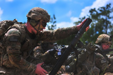A mortarman assigned to the 2nd Battalion, 325th Infantry Regiment, 2nd Brigade Combat Team, 82nd Airborne Division, simulates firing an M224 60mm mortar during a Combined Arms Live Fire Exercise on Fort Bragg, N.C., Aug. 9, 2016. The BCT conducted the CALFEX in preparation for battalion-level live fire exercises later this year, keeping Paratroopers ready to jump, fight and win.