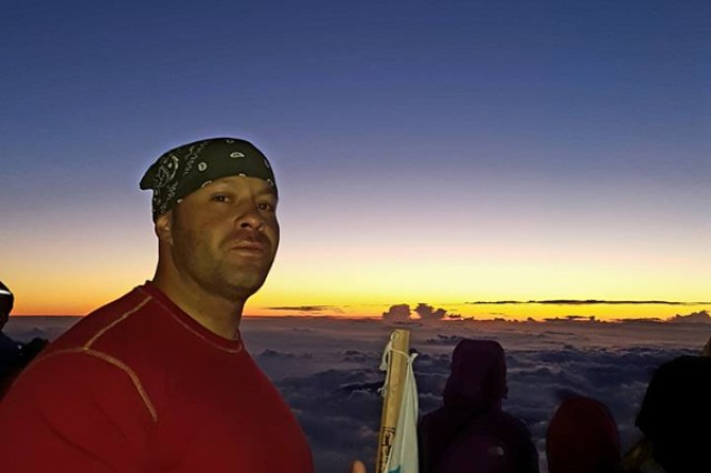 Chief Warrant Officer 3 Manuel Marrero at the top of Mount Fuji, Japan.