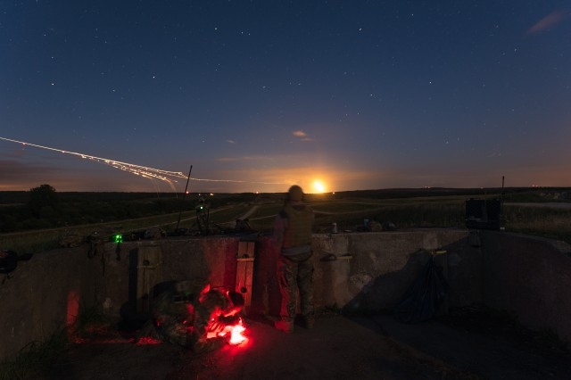 An AH-64 Apache helicopter from 1st Battalion, 3rd Aviation Regiment, 12th Combat Aviation Brigade, engages targets at night on the range at Grafenwoehr training area, Germany, Aug. 10, 2016.  Aviation gunnery trains individuals, crews, and companies on weapons proficiency and validates the operational readiness of the unit.  (U.S. Army photo by Spc. Antonio Ramirez, 12th CAB)