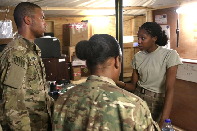 Spc. Tamicha Volcy, right, the postal clerk with Alpha Detachment of 4th Platoon, 912th Human Resource Company, 90th Human Resource Company, 17th Special Troops Battalion, 17th Sustainment Brigade, 1st Sustainment Command (Theater), explains mail room procedures to new Soldiers at a base in Southwest Asia, August 15, 2016. A/4 912th HR Company. has delivered more than 5,600 pieces of mail weighing over 145,000 pounds over the last eight months.