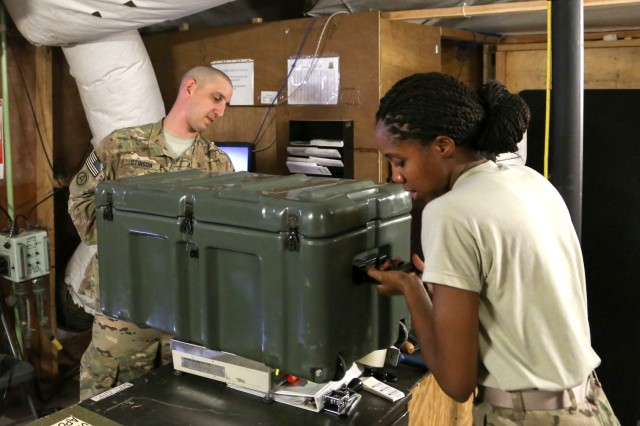 Spc. Tamicha Volcy, right, the postal clerk with Alpha Detachment of 4th Platoon, 912th Human Resource Company, 90th Human Resource Company, 17th Special Troops Battalion, 17th Sustainment Brigade, 1st Sustainment Command (Theater), helps 1st Lt. Jacob Stinson, the supply officer in charge, 1st Battalion, 182nd Field Artillery, weigh a package at a base in Southwest Asia, August 15, 2016. A/4 912th HR Company has processed more than 2,800 parcels of outgoing mail weighing over 64,000 pounds over that last eight months.