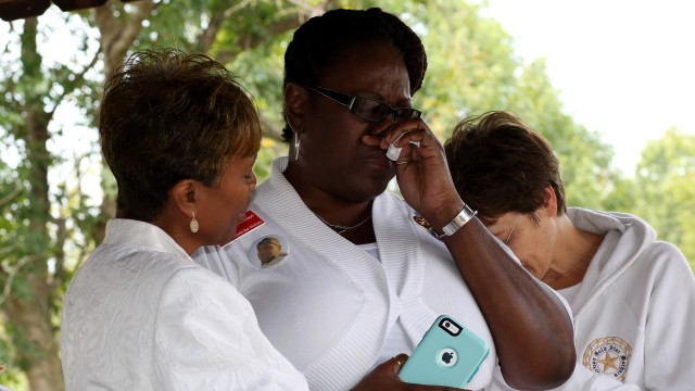 Gold Star Janice Chance consoles a survivor
