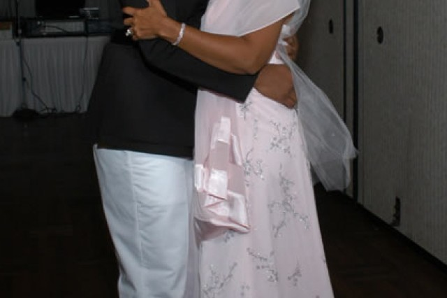 Marine Capt. Jesse Melton III dances with his mother Janice Chance during her renewal ceremony in 2005. After his death, Chance was inspired to carry on his legacy by serving the military community.