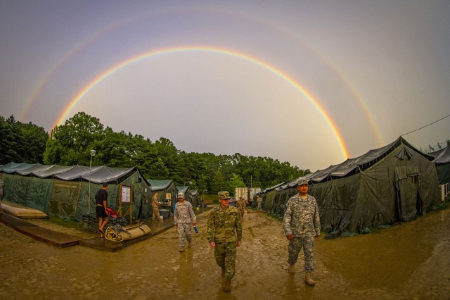 The rain subsides long enough for a rainbow to arch over a tent city constructed by I Corps and Korean army soldiers for U.S. and Canadian army personnel conducting a two-week training mission at Yongin, South Korea, Aug. 27, 2016.