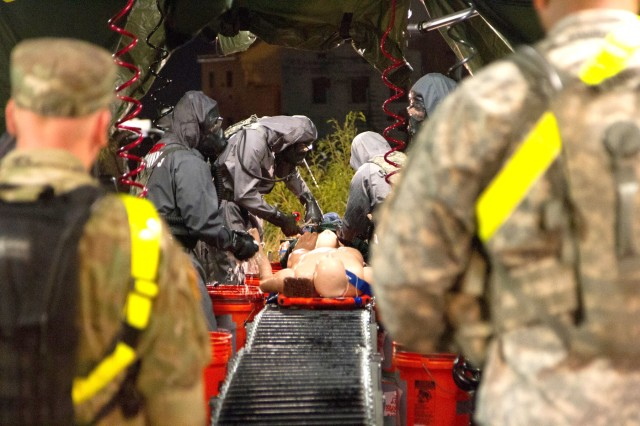Soldiers with the 172nd Hazard Response Company from Fort Riley, Kansas, run a decontamination site Aug. 25, 2016 at Fort Hood, Texas during Exercise Sudden Response 16.