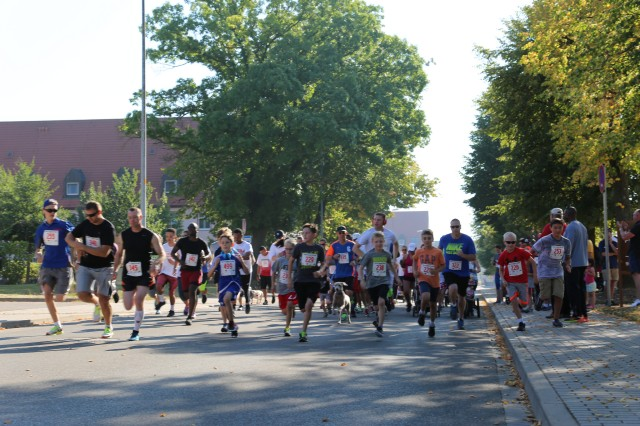 ANSBACH, Germany (Aug. 31, 2016) -- U.S. Army Garrison Ansbach community members start the Back-to-School Fun Run. Many different on- and off-post organizations took part in the Community Showcase at U.S. Army Garrison Ansbach to meet with community members at the Katterbach Fitness Center. The Back-to-School Fun Run preceded the annual showcase, wherein several participants in the child, youth, and adult categories won prizes. (U.S. Army photo by Bryan Gatchell, USAG Ansbach Public Affairs)