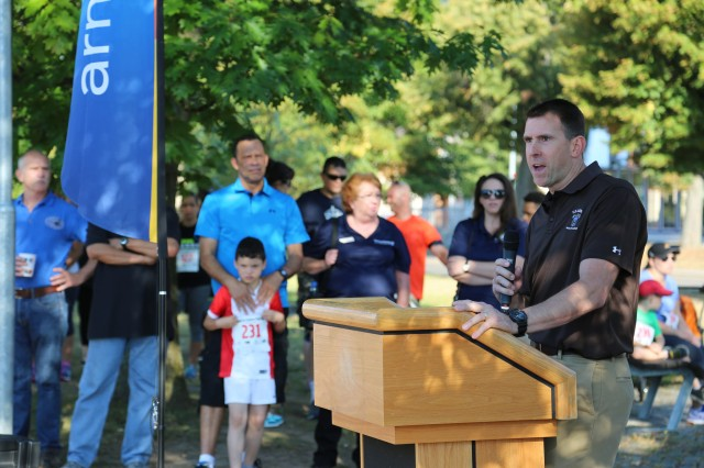 ANSBACH, Germany (Aug. 31, 2016) -- Col. Benjamin C. Jones, U.S. Army Garrison Ansbach commander, speaks before the fun run starts. Many different on- and off-post organizations took part in the Community Showcase at U.S. Army Garrison Ansbach to meet with community members at the Katterbach Fitness Center. The Back-to-School Fun Run preceded the annual showcase, wherein several participants in the child, youth, and adult categories won prizes. (U.S. Army photo by Bryan Gatchell, USAG Ansbach Public Affairs)