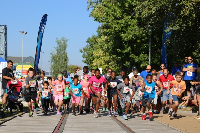 ANSBACH, Germany (Aug. 31, 2016) -- The Back-to-School Fun Run 500-meter dash for children ages 5 to 11 starts. Many different on- and off-post organizations took part in the Community Showcase at U.S. Army Garrison Ansbach to meet with community members at the Katterbach Fitness Center. The Back-to-School Fun Run preceded the annual showcase, wherein several participants in the child, youth, and adult categories won prizes. (U.S. Army photo by Bryan Gatchell, USAG Ansbach Public Affairs)