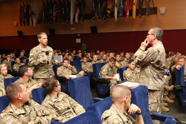 The Commander of U.S. Army Human Resources Command, Maj. Gen. Thomas Seamands, answers an attendee's question during a professional development briefing with Vicenza Military Community leaders, Aug. 29, 2016 at the Caserma Ederle Reel Time Theater, Vicenza, Italy. Seamands' visit was one of many scheduled destinations on a tour of military installations throughout Europe, known as the HRC Road Show. The discussion provided HRC with feedback on how policies affect Soldiers and also served as an opportunity for HRC to dispel rumors. (U.S. Army photo by Staff Sgt. Lance Pounds - 160829-A-BP709-028)
