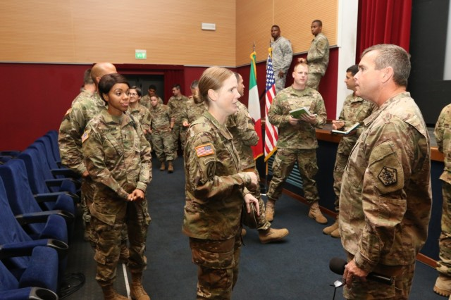 The Commander of U.S. Army Human Resources Command, Maj. Gen. Thomas Seamands, talks with attendees following a professional development briefing with Vicenza Military Community leaders, Aug. 29, 2016 at the Caserma Ederle Reel Time Theater, Vicenza, Italy. Seamands' visit was one of many scheduled destinations on a tour of military installations throughout Europe, known as the HRC Road Show. The discussion provided HRC with feedback on how policies affect Soldiers and also served as an opportunity for HRC to dispel rumors. (U.S. Army photo by Staff Sgt. Lance Pounds - 160829-A-BP709-048)