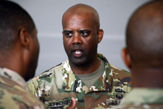 The Command Sergeant Major of U.S. Army Human Resources Command, Command Sgt. Maj. Wardell Jefferson, talks with attendees following a professional development briefing with Vicenza Military Community leaders, Aug. 29, 2016 at the Caserma Del Din Gymnasium, Vicenza, Italy. Jefferson's visit was one of many scheduled destinations on a tour of military installations throughout Europe, known as the HRC Road Show. The discussion provided HRC with feedback on how policies affect Soldiers and also served as an opportunity for HRC to dispel rumors. (U.S. Army photo by Staff Sgt. Opal Vaughn - 160829-A-MM054-026)