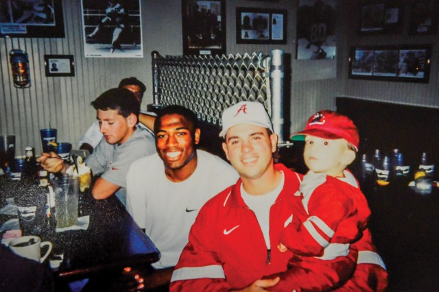Alexander and Mayfield and his son, Bryce, in a restaurant in Tuscaloosa, AL Nov 1998.