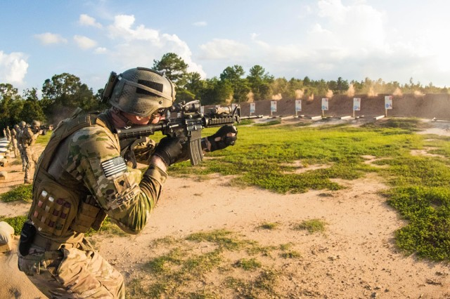 """An infantryman assigned to Foxtrot Company """"Pathfinders,"""" 2nd Assault Helicopter Battalion, 82nd Combat Aviation Brigade, engages his target, during a reflexive fire range training event at Fort Bragg, N.C., Aug. 11, 2016."""
