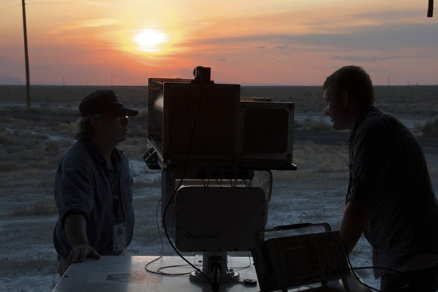 Two private industry scientists prepare their standoff detector for a simulated agent trial with the distant Active Standoff Chamber (not pictured). Standoff detectors detect a chemical or biological cloud at a distance, avoiding contamination of the system and those operating it. Dugway Proving Ground is noted for its stunning sunsets and sunrises.Photo by Al Vogel / Dugway Public Affairs.