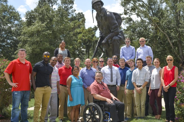 "U.S. Army Sustainment Command Intern BootCamp participants pose in front of ""Iron Mike"" during a tour at Fort Bragg, North Carolina, Aug. 17. ASC Intern BootCamp is a five week training program designed to educate participants about how the Army and ASC operates."