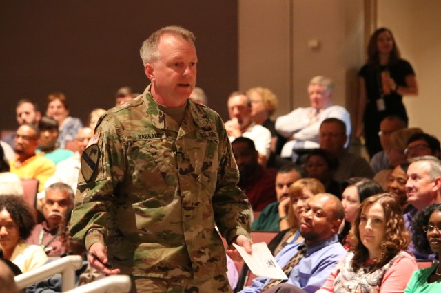 Maj. Gen. Douglas Gabram, commander of the Aviation and Missile Command, speaks to employees as we walks through the crowd attending the AMCOM Town Hall in the Sparkman Center's Bob Jones Auditorium Aug. 29, 2016, Redstone Arsenal, Ala.