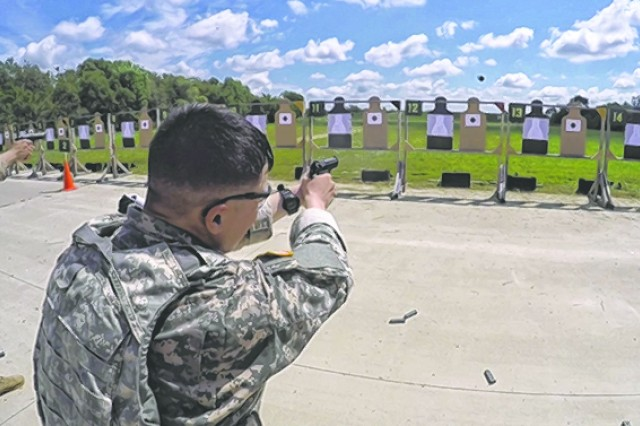 A competitor in the 75th Military Police Anniversary Competitive Challenge held on Fort Leonard Wood competes in the 9 mm stress fire course.