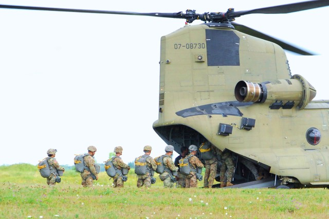 Soldiers attending the Pathfinder Mobile Training Team course load a CH-47 Chinook helicopter in preparation for an airborne operation at Fort Drum. This is the first airborne operation conducted by the 10th Mountain Division (LI) in more than a decade.